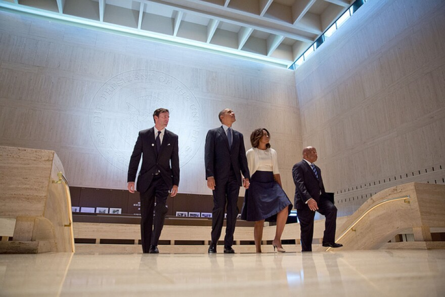 Mark Updegrove (left) with President Barack Obama. Michelle Obama and Rep. John Lewis (D-Georgia) at the LBJ Presidential Library.