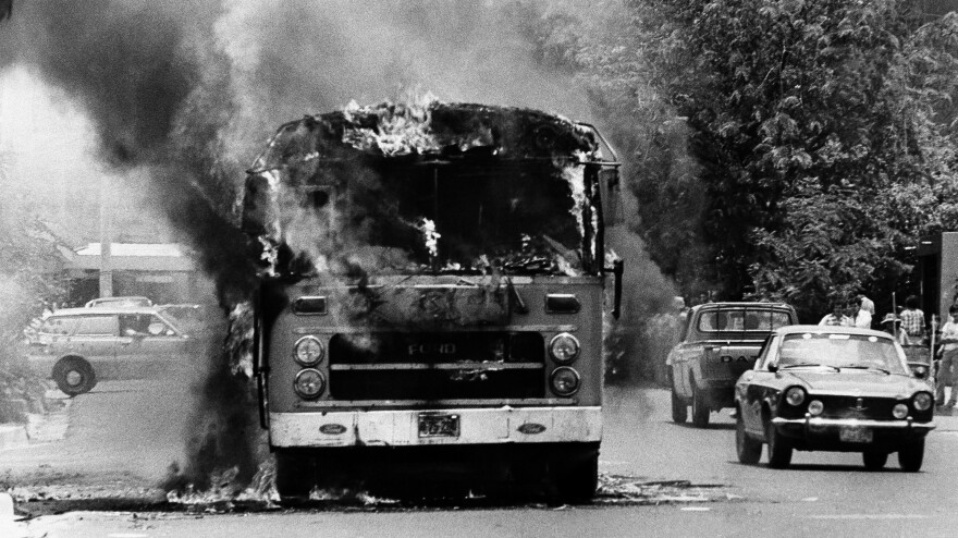 A bus burns in the streets of San Salvador on May 15, 1979, after it was set on fire by leftist demonstrators.