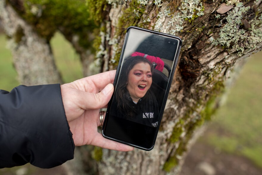 "Kimberly Conger, Sarah McSweeney's nurse at her group home, shows a photo of McSweeney on her phone. She says McSweeney was outgoing and fun: ""She absolutely adored going into malls and getting her makeup done and getting her hair done."""