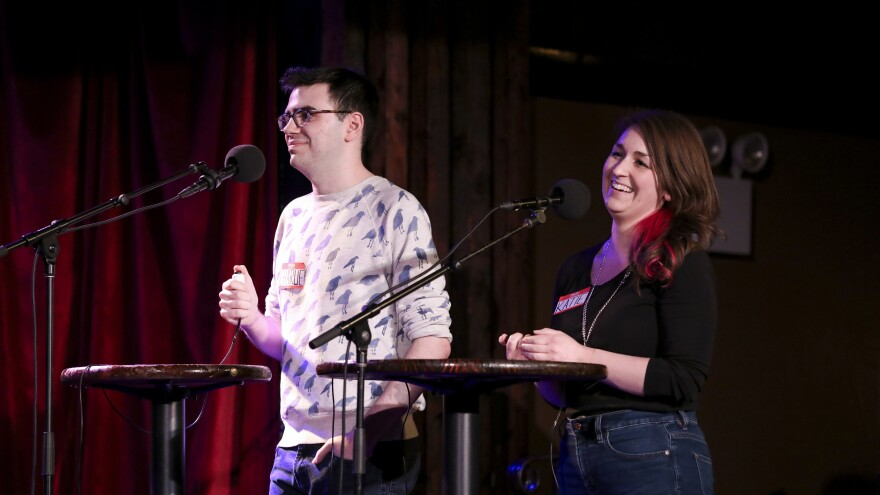 Contestants Charlie Rubinovitz and Katie Rogers appear on Ask Me Another at the Bell House in Brooklyn, New York.
