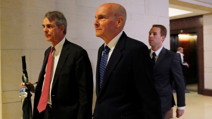 Michael McKinley (center), former senior adviser to Secretary of State Mike Pompeo, arrives to testify at a closed-door deposition as part of the Democratic-led impeachment inquiry into President Trump.