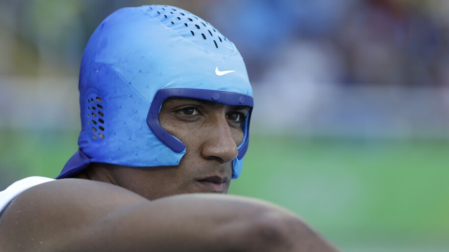 Eaton wears a cooling cap during the decathlon competition on Wednesday. The decathletes were on the track from early in the morning until late in the evening both Wednesday and Thursday.