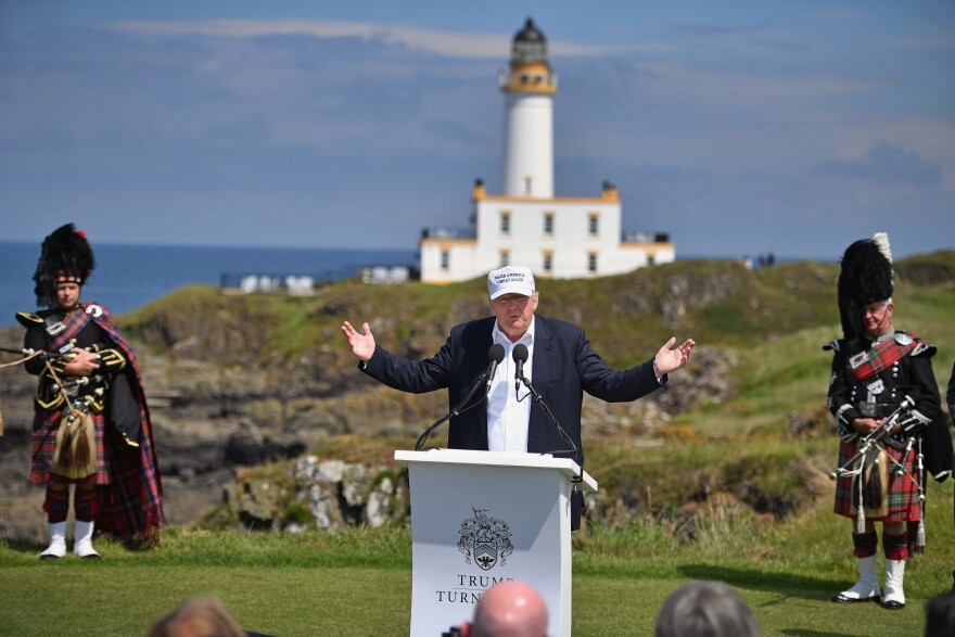 Donald Trump during a press conference at his Turnberry golf resort in Scotland in 2016 before becoming president. The U.S. Air Force confirms it's investigating claims that aircrews violated internal rules by staying at the resort. Trump says he had no knowledge of the stopovers.