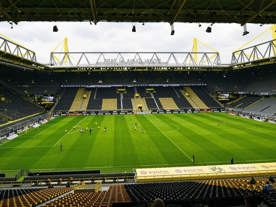 Empty seats are seen in the Signal Iduna Park without spectators during the German Bundesliga soccer match between Borussia Dortmund and Schalke 04 in Dortmund, Germany on Saturday