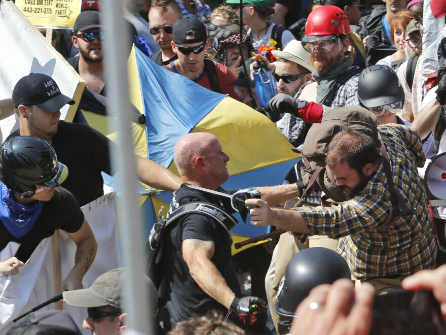 White nationalists clash with counterprotesters Saturday at a Charlottesville, Va., park where a statue of Confederate Gen. Robert E. Lee is set to come down.