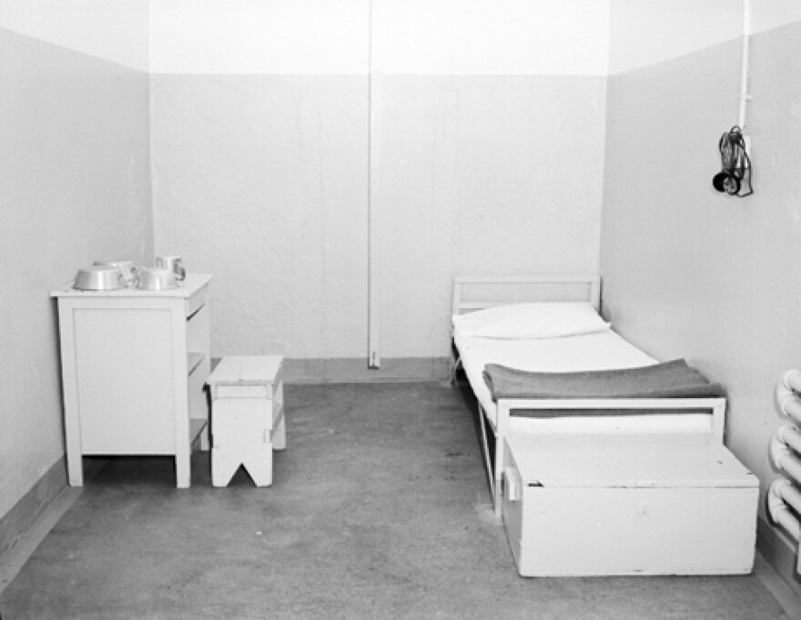 An archival image from 1950 of the interior of a cell used for solitary confinement at Eastern State Penitentiary.