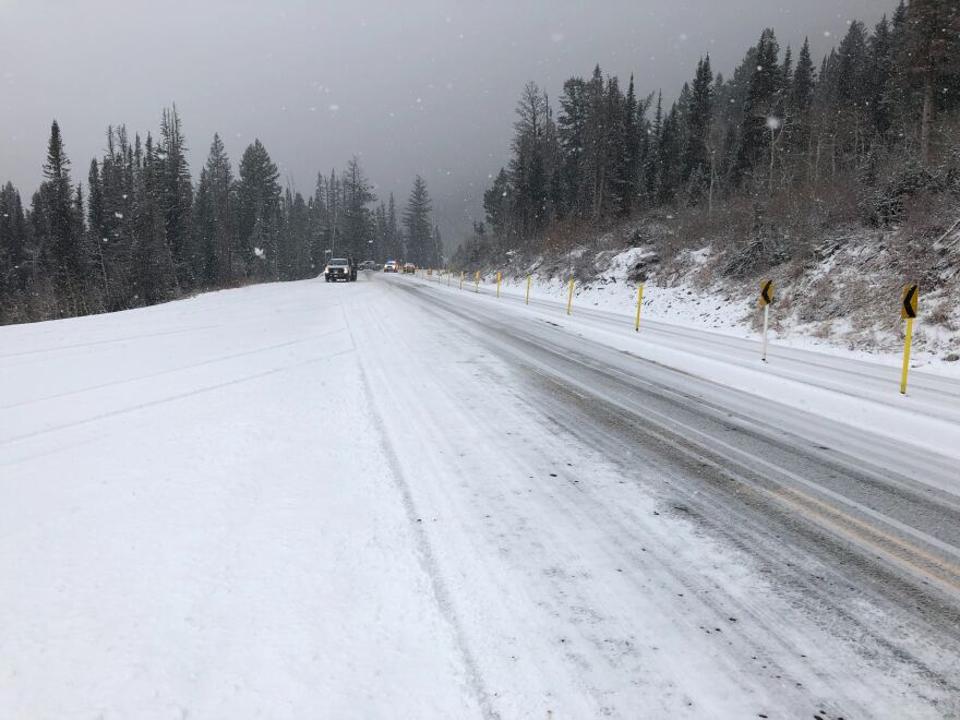 Mountain road covered in snow.