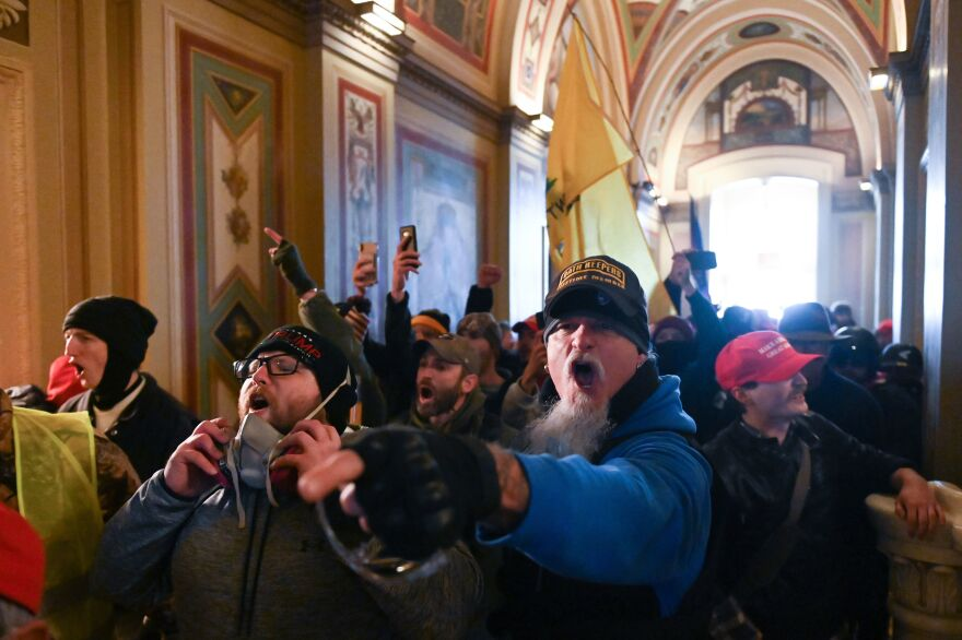 Demonstrators breeched security and entered the Capitol as Congress debated the a 2020 presidential election Electoral Vote Certification on Wednesday.