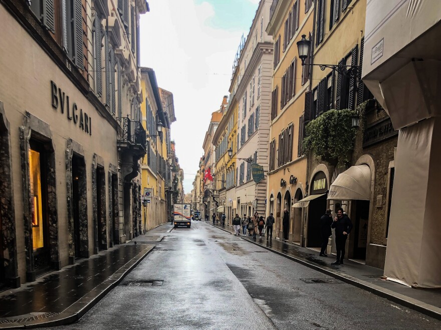 Via Condotti, Rome's high-end fashion street, usually crowded with visitors carrying bags from famous clothing boutiques, is now like a ghost town.