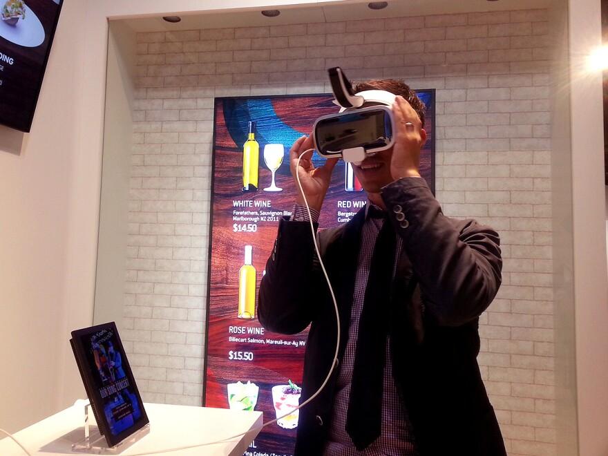 NPR reporter Ari Shapiro tries virtual reality goggles at the Samsung Innovation Museum near Seoul.