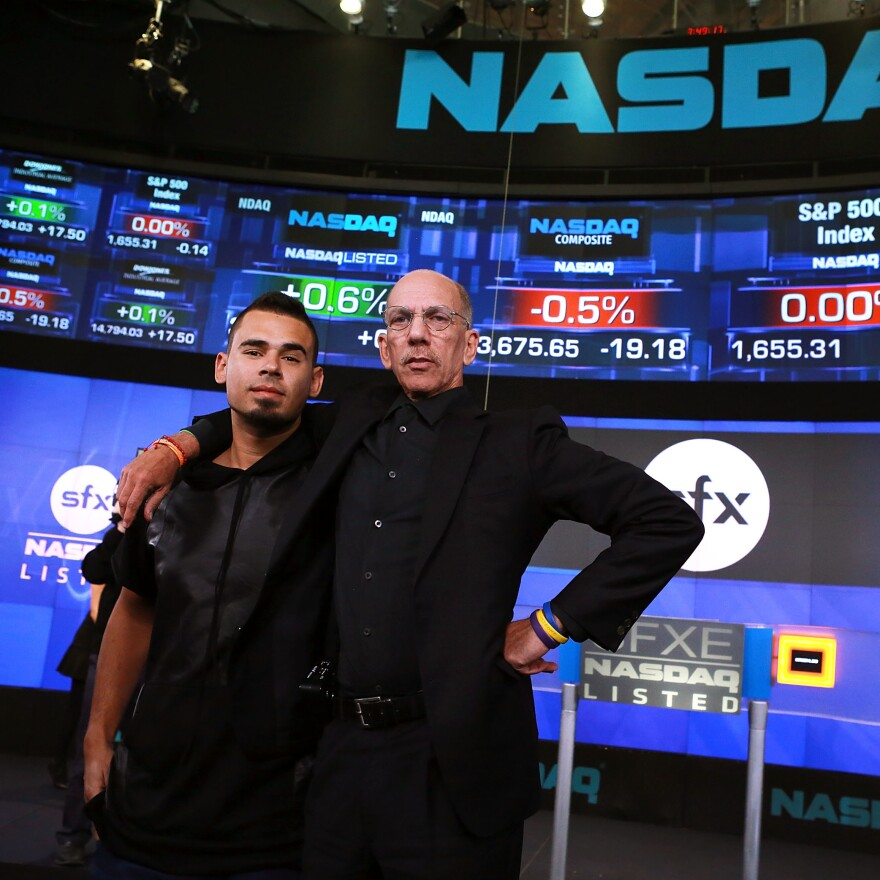 Producer and DJ Afrojack, left, with Robert F.X. Sillerman, in 2013. Sillerman was the co-founder and CEO of the now-defunct electronic dance music promotion company SFX, pictured here on the day it went public.