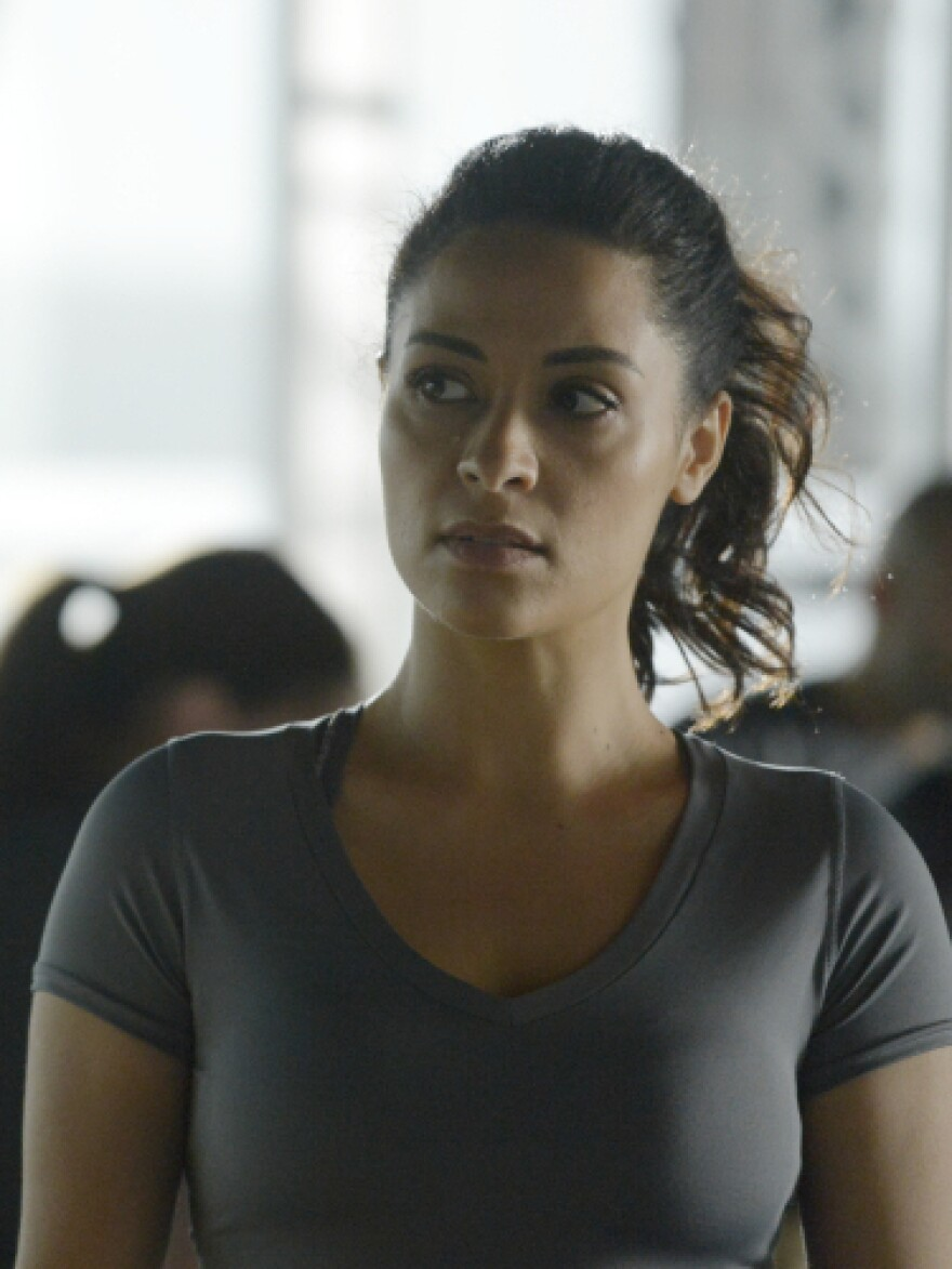 Massri also plays Nimah Amin, Yasmine's twin sister, who does not wear the hijab.