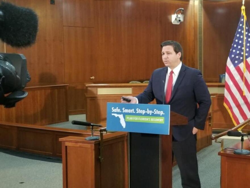 Gov. Ron DeSantis at the podium