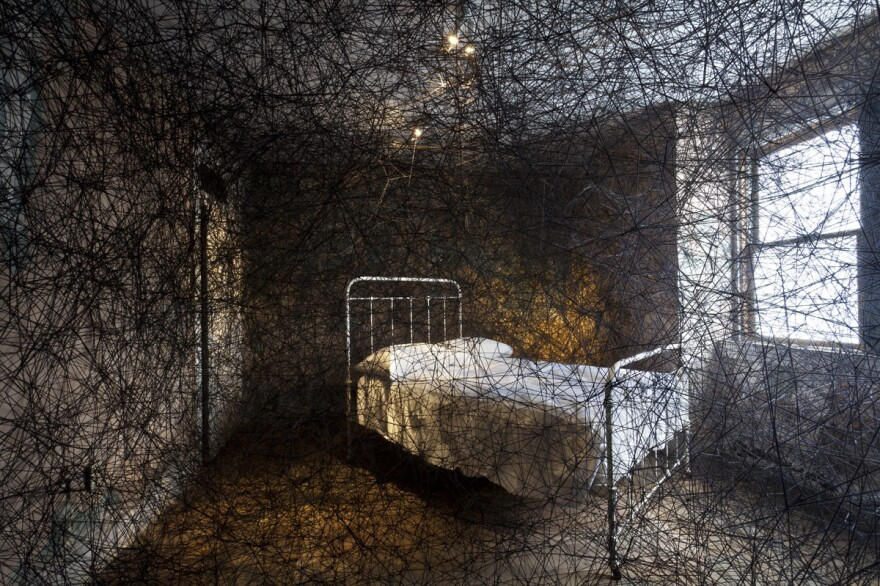 """Chiharu Shiota takes over an entire townhouse for her 2013 work <a href=""""http://www.mattress.org/archive/index.php/Detail/Entities/1452"""">Trace of Memory</a>. It's one of the many unusual installations at The Mattress Factory in Pittsburgh."""