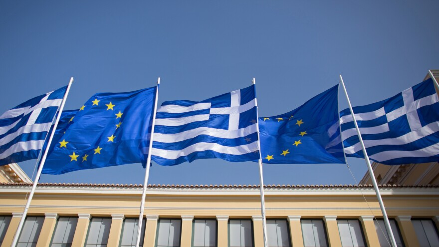 """Greek flags fly beside those of the European Union in Athens. Many people chalk the phrase up to Shakespeare, but its origins likely date back much earlier than that --€"""" to medieval monks eager for a cop-out."""