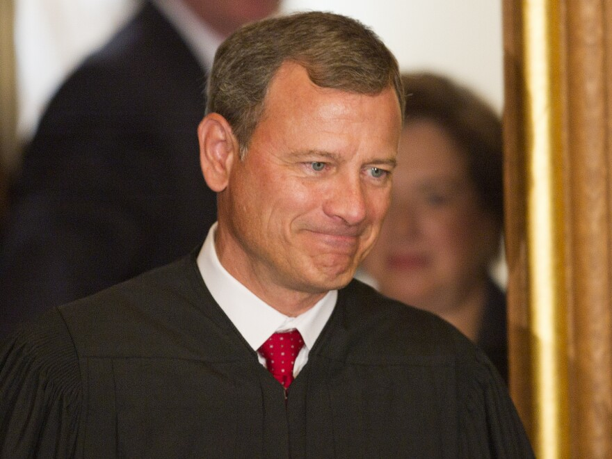 """Chief Justice John Roberts, shown in 2010, is still """"finding his role as chief justice,"""" says one law professor."""