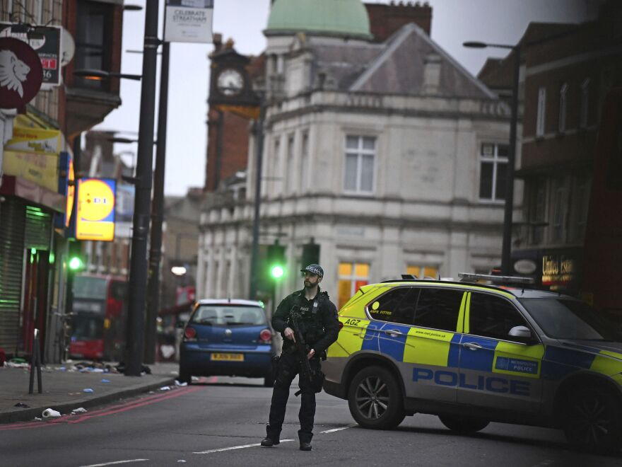 "London police say officers shot and killed a suspect in a ""terrorist-related"" stabbing incident Sunday."