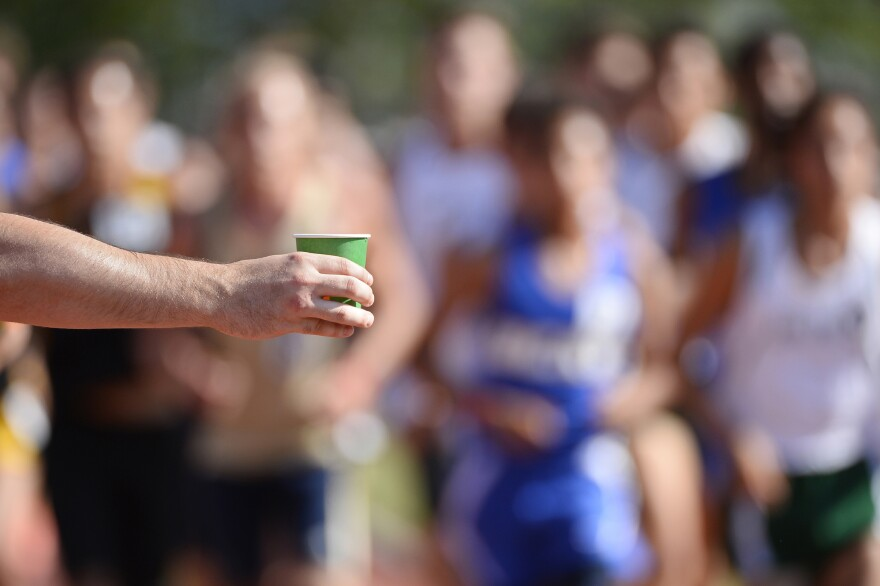 Performance nutrition experts recommend stopping at all the hydration stations for a quick fill-up of a sports drink to replenish the glycogen that's being burned during a marathon.