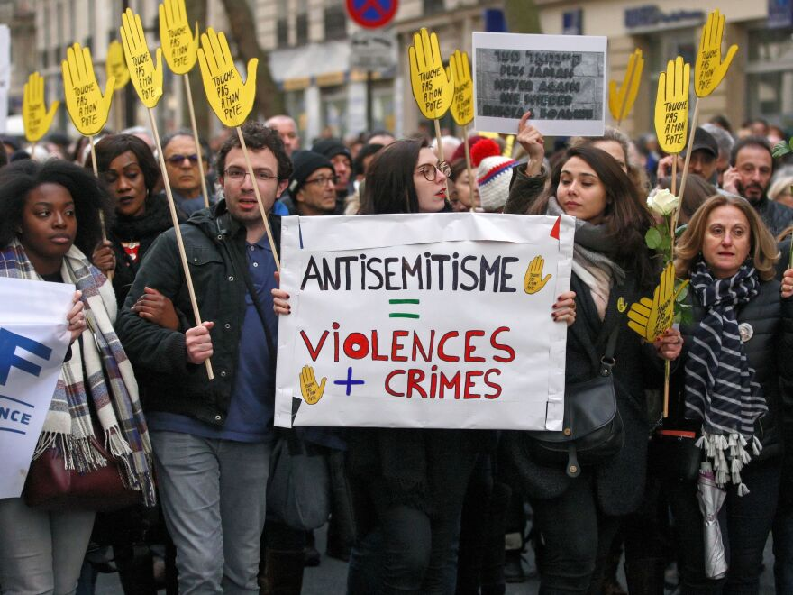 Demonstrators hold signs against anti-Semitism during a silent march in Paris on March 28 in memory of Mireille Knoll, an 85-year-old Jewish woman murdered in her home in what police believe was an anti-Semitic attack. Knoll escaped the mass deportation of Jews from Paris during World War II.