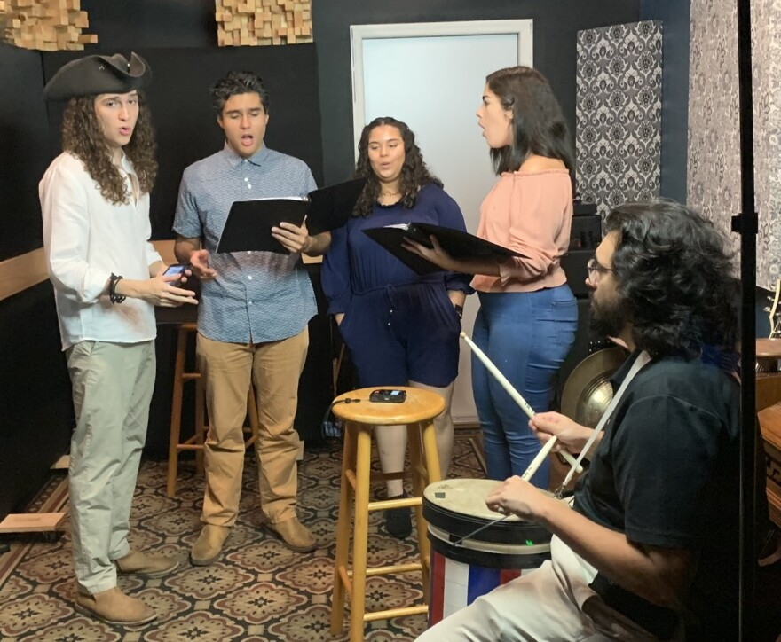 Some members of Voices of Freedom rehearse on a recent day. From left to right they are: Miguel Arango, Anthuan Rubbio, Vanesa Rodriguez, Vanessa Ruano and Federico Arango.
