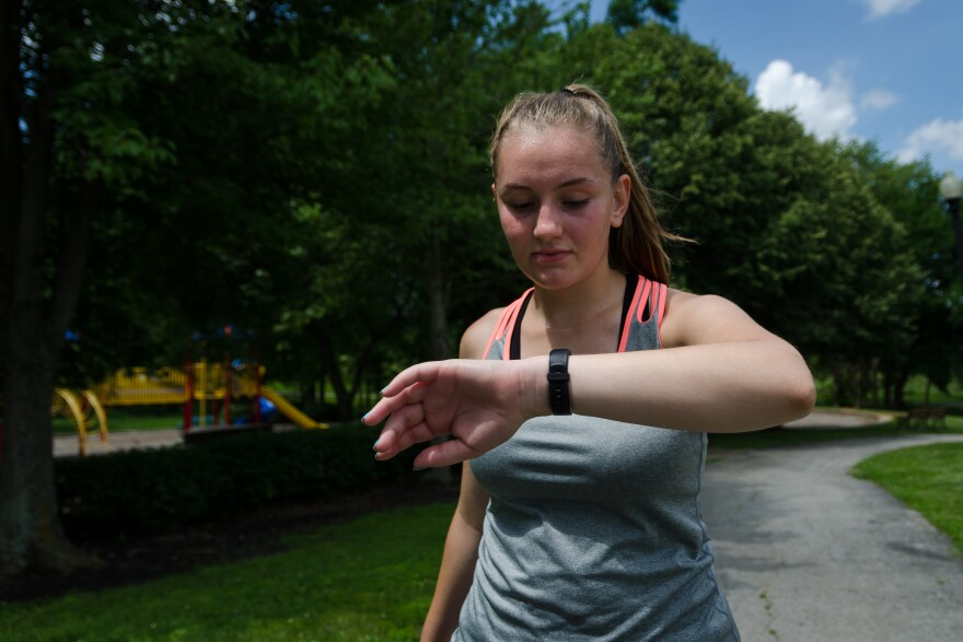 Nora Pryor, 15, checks her fitness tracker during several laps of Boulevard park in Lake St. Louis June 26, 2019. She must complete seven hours of physical activity per week as part of her online physical education course.