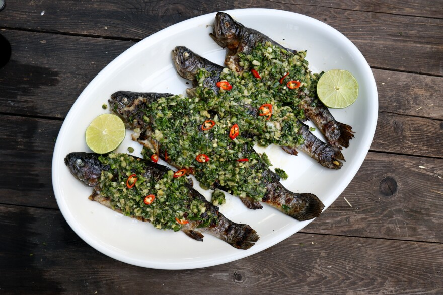 Grilled rainbow trout with scallion verde sauce. Yia Vang, co-founder of Union Kitchen, says he likes to relate each plate's origin to people.