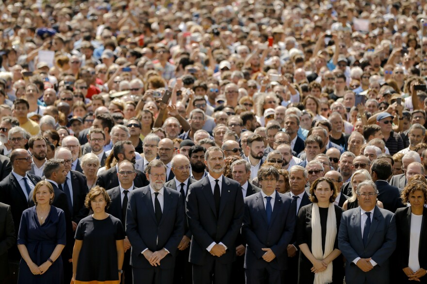 Prime Minister Mariano Rajoy (from center left), King Felipe VI of Spain, Catalonia regional President Carles Puigdemont and Barcelona Mayor Ada Colau join people in observing a minute of silence on Friday in memory of the terrorist attacks victims in Las Ramblas, Barcelona.