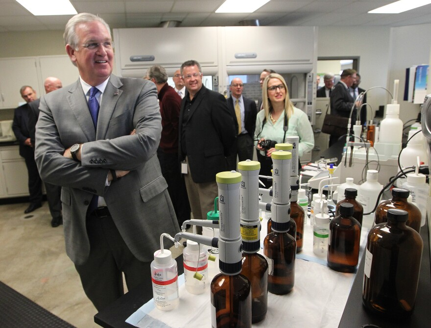 Gov. Jay Nixon takes a tour last week of Spectrum's new headquarters in Earth City. Nixon is aggressively championing a new stadium for the Rams.