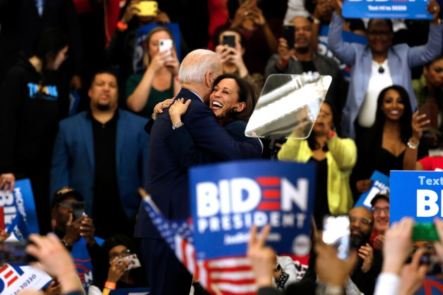 Sen. Kamala Harris hugs Democratic presidential candidate Joe Biden after she endorsed him at a campaign rally in Detroit on March 9, 2020.