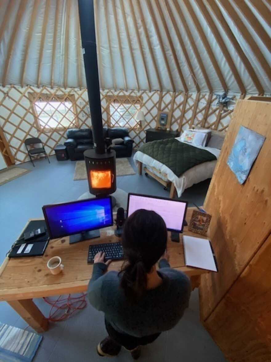 Dr. Anne Zink works from a yurt behind her family home, with three phones and three laptops, sometimes starting at 4 a.m.