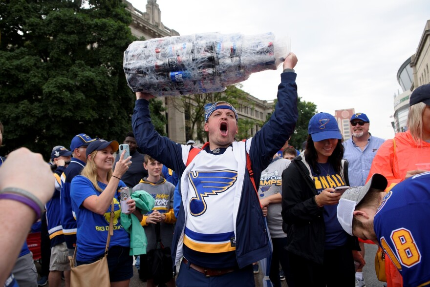 """Danny Tobben of Washington, Mo. celebrates after chugging beer from a """"Stanley Cup"""" made from beer cans during the Blues championship parade. June 15, 2019"""