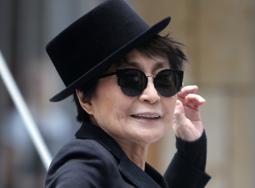"""Yoko Ono poses during the opening of her exhibition """"half-a-wind show"""" in Frankfurt, Germany."""