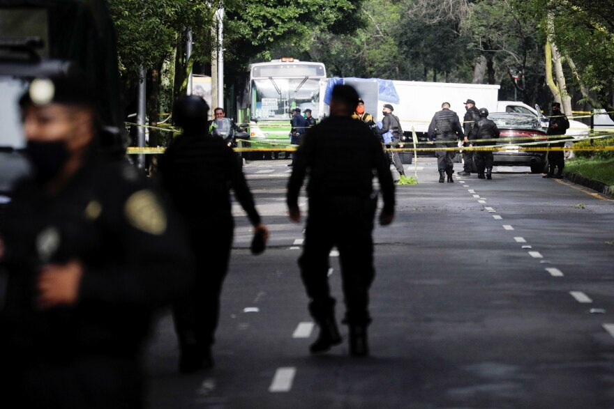 Police officers guard a crime scene following an assassination attempt on Mexico City's chief of police Omar García Harfuch, in Mexico City last month.