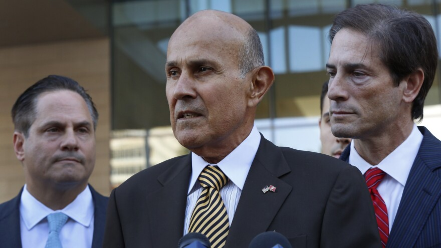Ex-LA County Sheriff Lee Baca, with attorneys David Hochman (left) and Nathan Hochman, talks to the media as he leaves federal court in Los Angeles on Wednesday, after being convicted of obstructing an FBI corruption investigation of jails he ran and of lying to federal authorities.