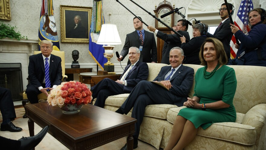 President Trump meets with Senate Majority Leader Mitch McConnell, R-Ky., Senate Minority Leader Chuck Schumer, D-N.Y., House Minority Leader Nancy Pelosi, D-Calif., and other congressional leaders in the Oval Office. According to <em>The Washington Post</em>, Trump and Schumer have agreed to work on a plan to eliminate the debt ceiling.