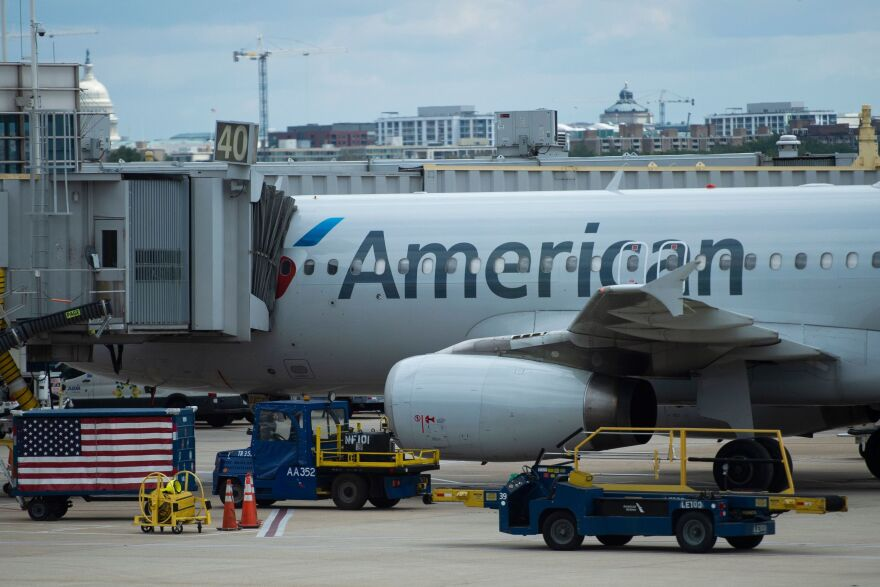 An American Airlines plane is seen at a gate at Ronald Reagan Washington National Airport in Arlington, Va., on May 12, 2020.