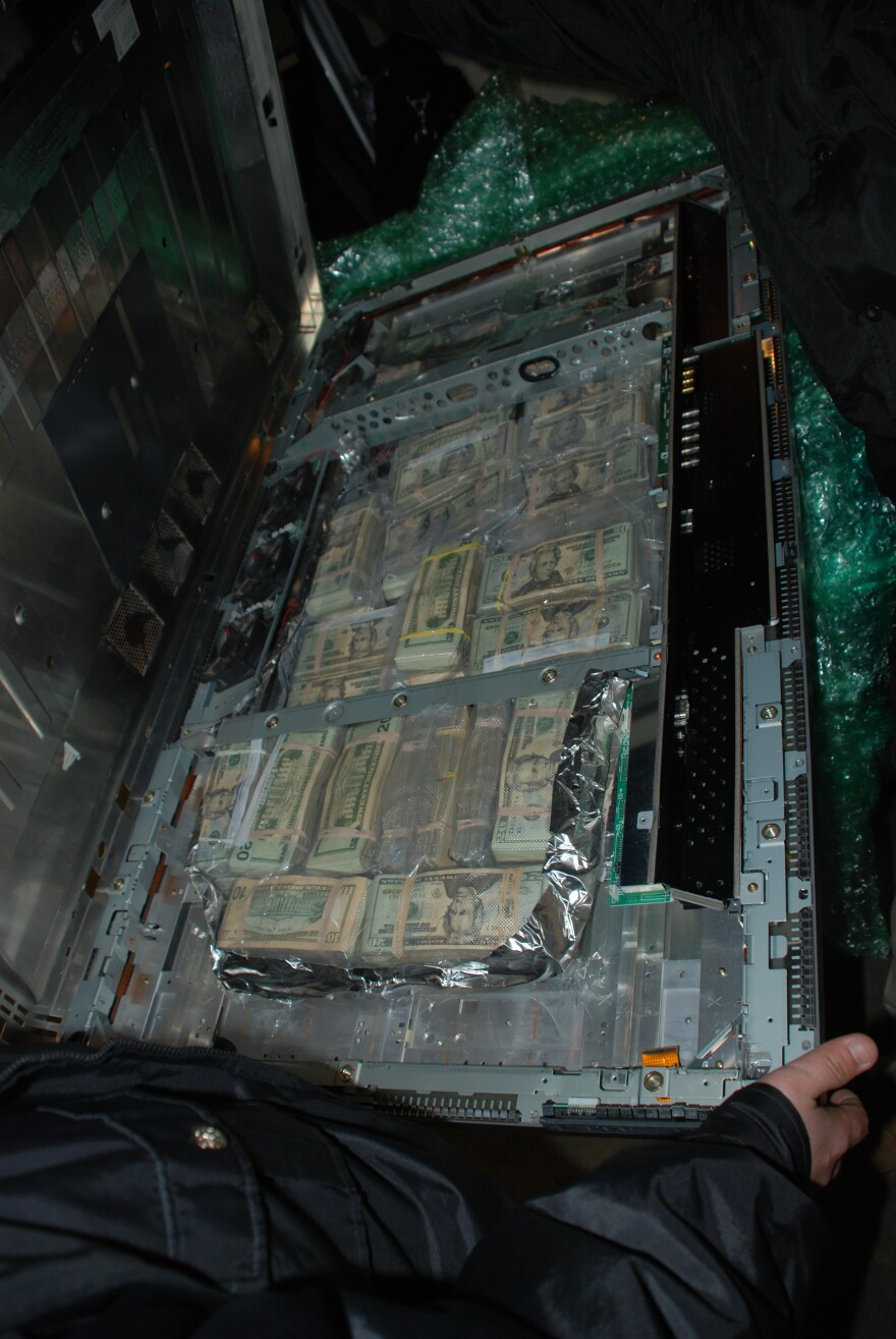 A photo provided by the Phelps County Sheriff's Department shows a flatscreen TV stuffed with cash that the department seized.