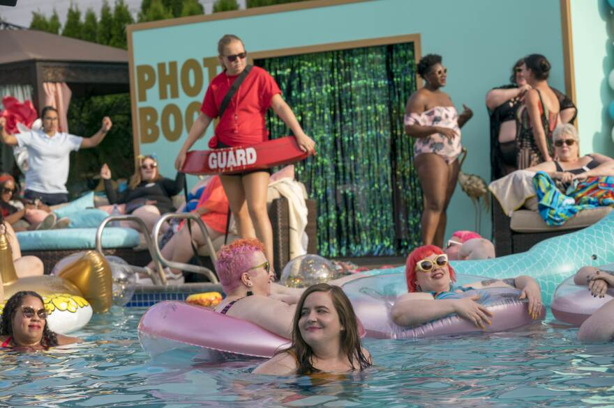 """West says swimming is """"the greatest of all the human activities"""" and she mourns the many years that she avoided it because she felt bad about her body. Above, Annie (Aidy Bryant) attends the Fat Babe Pool Party."""