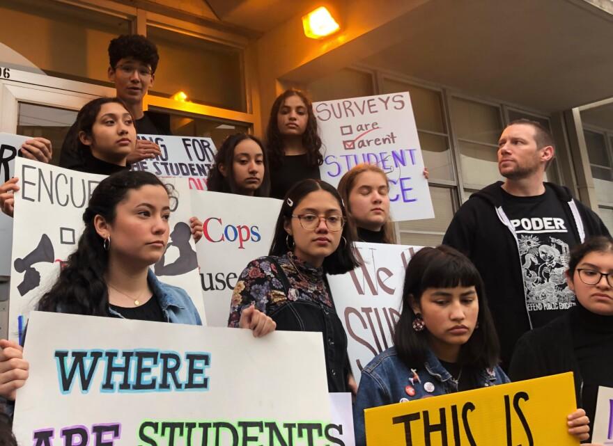 Burbank teacher Luke Amphlett, right, joined students in a protest outside a board meeting in February 2020. The Alliance says Amphlett was placed on leave after expressing concerns about Burbank's reopening plan.