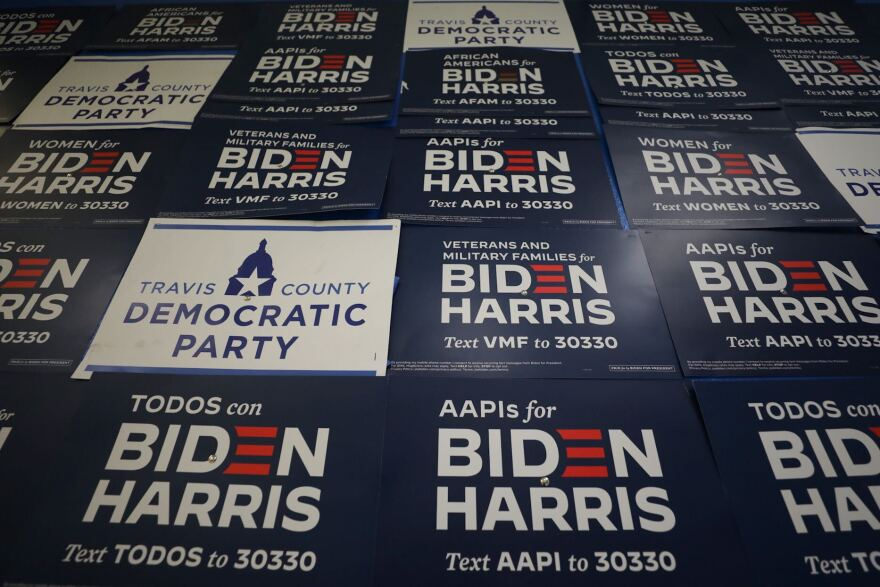 Joe Biden signs cover the wall at the Travis County Democratic Party's Southwest office on election night.