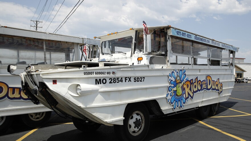 A duck boat sits idle in the parking lot of Ride the Ducks, an amphibious tour operator in Branson, Mo., in July 2018. The company has since closed.