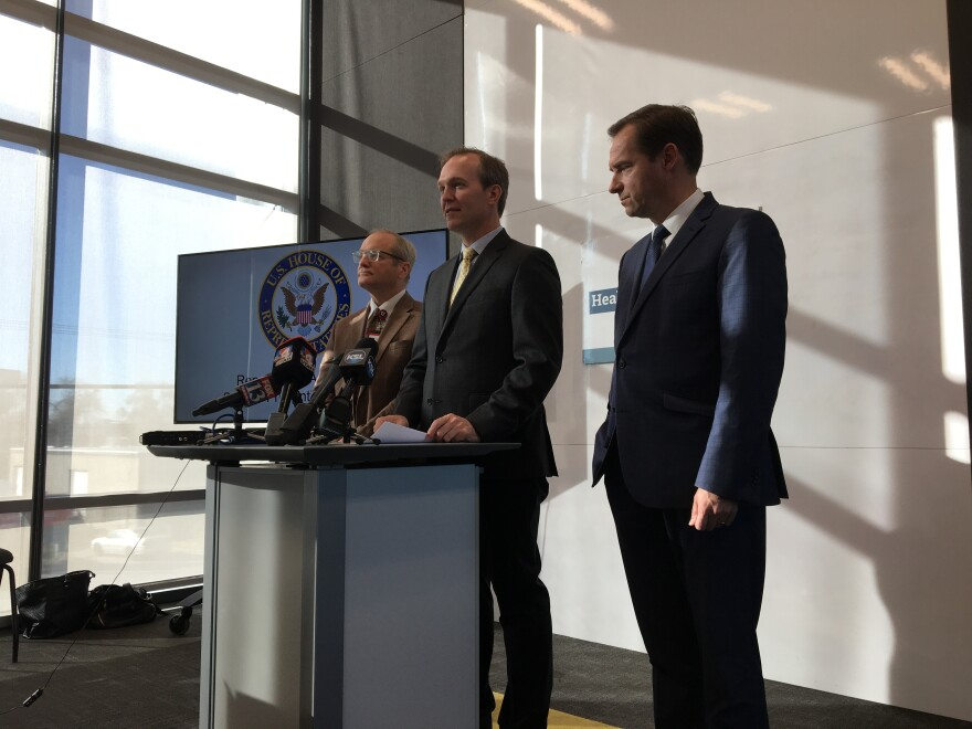 Photo of University of Utah suicidologist Dr. Doug Gray, Rep. Ben McAdams, and state Rep. Steve Eliason, R-Sandy, at a press conference.