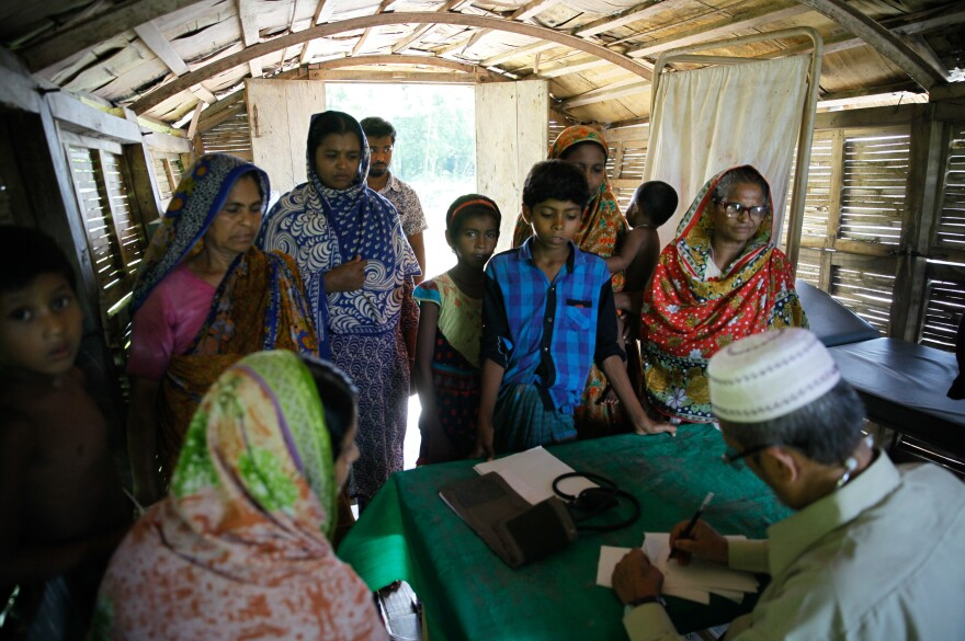 Villagers wait to see a doctor at a Shidhulai Swanirvar Sangstha floating clinic. On different days the boat docks at different points along the river.