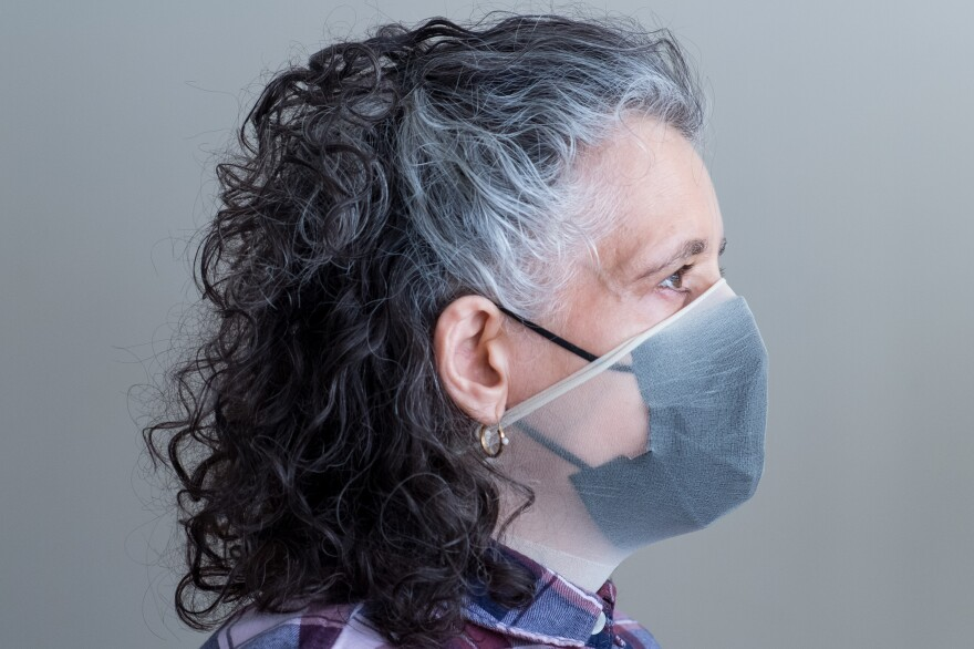 If you want to try the pantyhose trick, cut a<strong> </strong>ring of material, about 8 to 10 inches top to bottom, from one leg on a pair of pantyhose. Then pull the ring over your head and on top of your mask to create a tight fit to the face.