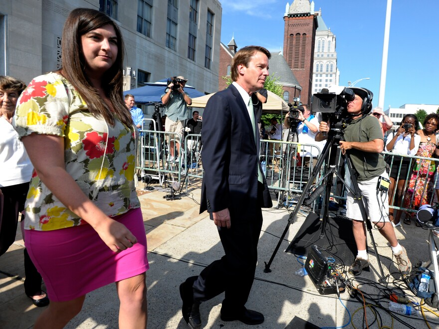 Former Democratic U.S. Sen. John Edwards (center) and his daughter Cate Edwards leave the federal court Thursday.