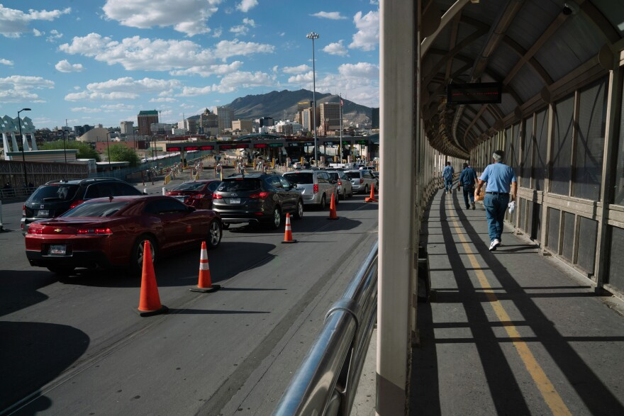 Cars and pedestrians cross the Paso del Norte International Bridge, which runs between Juárez, Mexico, and El Paso, Texas, on Tuesday.
