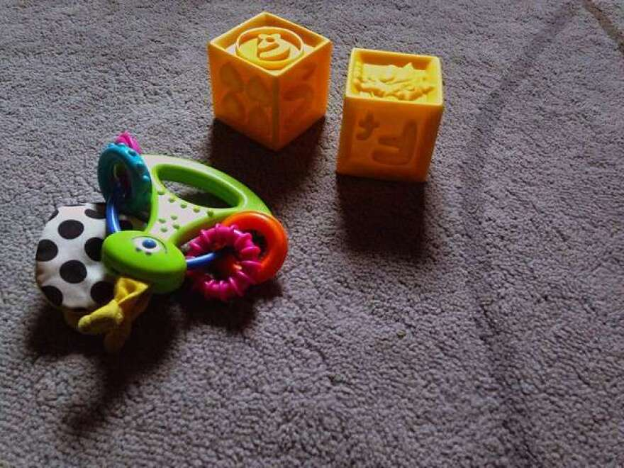 Baby toys set on a floor