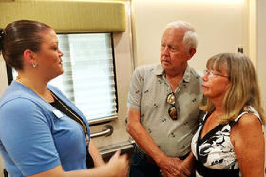Jill Smith (left), asst. dir. for clinical research at the Byrd Alzheimer's Institute, talks to clinical trial participant Bill Nagely of St. Petersburg and his wife, Sheila, inside the Mobile Suite.