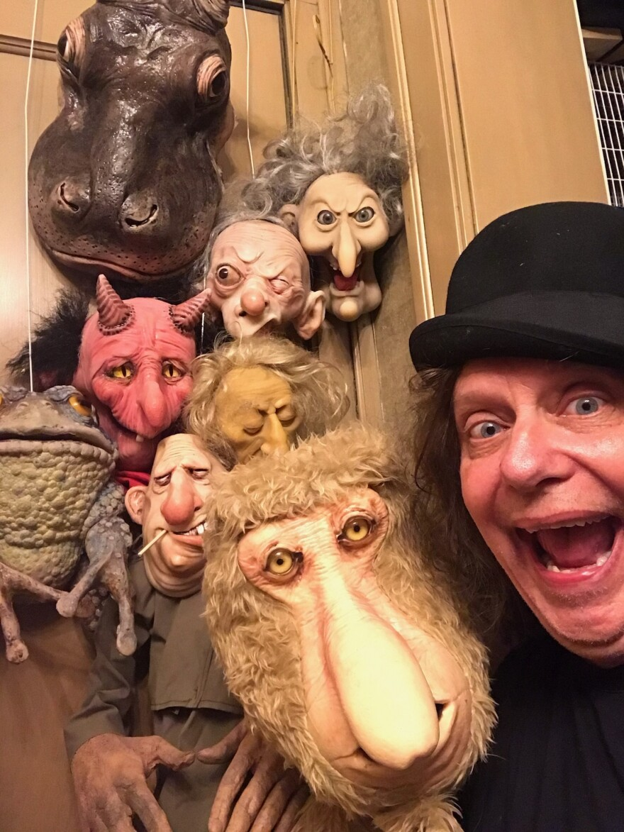 Matthew Owens, founder of the Lockdown Puppet Theater, with his puppets.