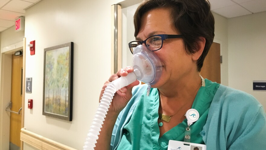 Nurse-midwife Cynthia Voytas demonstrates equipment used to deliver nitrous oxide at South County Hospital in South Kingstown, R.I.